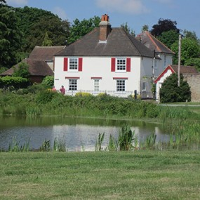 Gerrards cross common with pond and white house in the backgroun