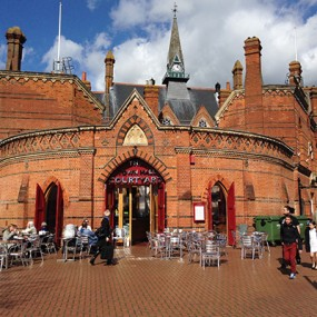 Wokingham town centre with cafe outside