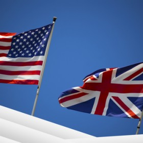 Flags on blue sky background of UK and UK