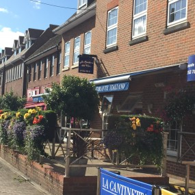 Farnham Common shop with flowers on fencing