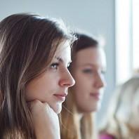people listening to a teacher