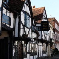 Old Amersham kings arms hotel building with beams and blue sky