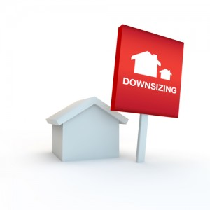 red sign on a white background with house concept of downsizing