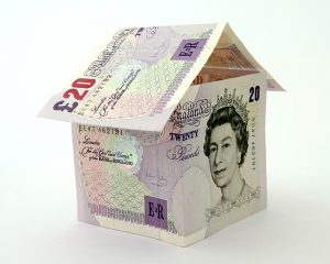 £20.00 notes in the shape of a house with a roof