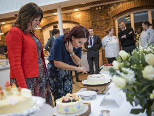 Candice Brown judging the school cake display