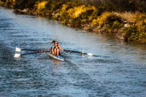 two people rowing on the river