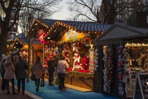 Christmas market stalls in dark